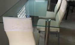 Dinning Table Glass Top with 4 leather Chairs Very Good