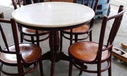 I HAVE A DINNING TABLE WITH 4CHAIRS FOR SALE. IN GOOD