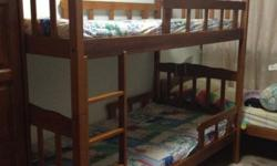 Double decker wooden frame bed, two single mattresses