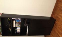 Dark Brown shelf with closed cabinets can be used for
