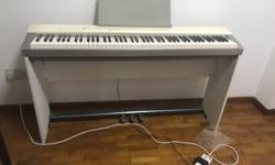 An electronic piano in good condition for sale
