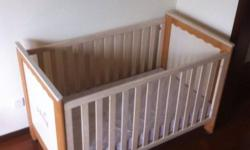 Elegant wooden baby cot in excellent condition for your