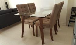 Dining table with tempered glass top. Wooden legs