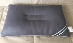 Selling this SuzuranBed Ergonomic pillow as I do not