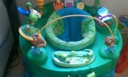 ExerSaucer for baby. It can transform into 3 different