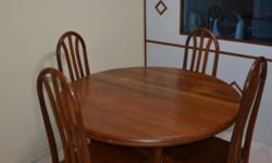 A unique and a solid wood dining table Extendable to an