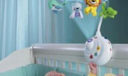 Fisher Price baby cot mobile with remote that is in