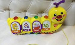 Preloved Fisher price caterpillar pull along toy In