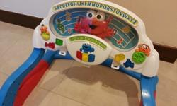 Comes with music and elmo can play peek-a-boo. Play gym