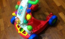Fisher Price Walker and Baby Chair. Walker condition is