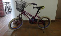 Purple bicycle with white wheels and handlebars. Suit