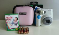 The instant camera is brand new I got from lucky draw..