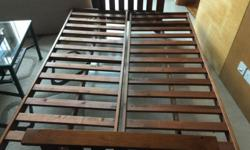 Teak wood futon for sale. Can be converted into a queen