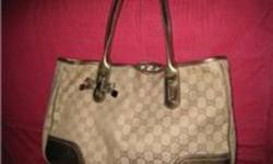 I am selling a gently used Gucci 100% authentic bag,