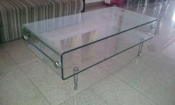 Glass coffee table with stainless steel vacuum joint