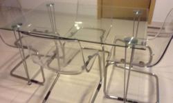 Glass dinning table with 4 chairs letting go at $380.