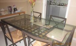 Excellent condition Glass top 4 chair Dinning Table for