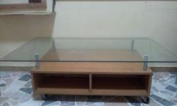 Only 8 months used glass top tv console for sale.