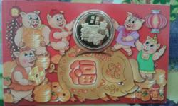 Gold coin year of the pig New in package 30 sgd only