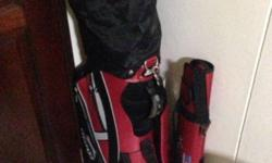 1whole set of golf clubs with 1 small bag and a lot og