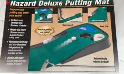 This is a good condition putting mat with hazard, and