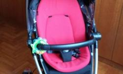 Red and Black used Quinny Pram for sale. Reversible