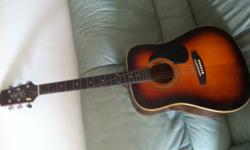 good condition VESTEC acoustic guitar with bag at olny