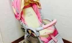A good conditioned pink and yellow color combition pram