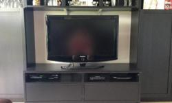 Stylish black gloss finish TV with stand. This has been