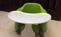Green Bumbo seat with tray for sale. Self collect or