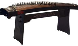 Amost new guzheng for sale comes with wooden stand,
