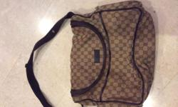 Used authentic Gucci Baby Bag with diaper changing mat.