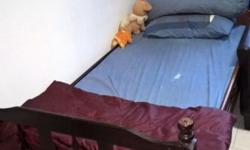 Selling a used hardwood single bed with mattress.