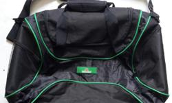 Heineken sports big black bag with green lines. Good