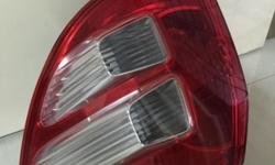Selling honda fit tail light right side Interest pls