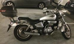 Well maintained Silver color honda phantom 150