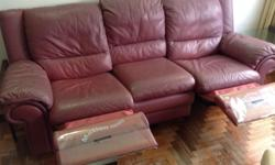 Leather sofa. Three seater. Two seats can recline.