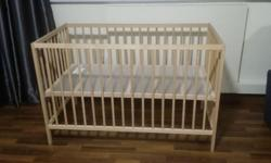 Ikea SNIGLAR Cot and mattress for sale. Both items were