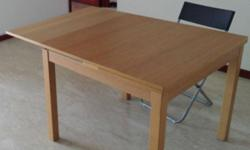 IKEA dining table and 4 chairs. Table is extensible,