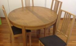 Ikea Dining Table, wood, with four wood chairs. The