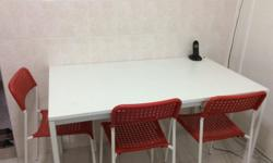 New ikea dinning table !! With four red chairs