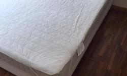 Hardly used queen sized Ikea mattress and bed base -