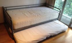 IKEA single bed with pull out underneath. Lower bed