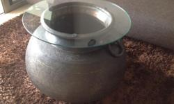 This pot was used in India in the olden days to cook.