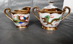 Antiques Japanese gilt dragon and phoenix milk pot and