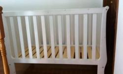 Great quality John Lewis wooden white cot bed is in