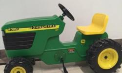 John Deere Pedal Tractor This four-wheeler pedal