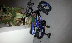 Kid?s cycle (blue color) with supporting wheels in a