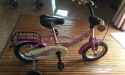 a first kid bike in pink colour in good condition with