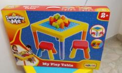-Toys r Us kids play table with blocks and two chairs.